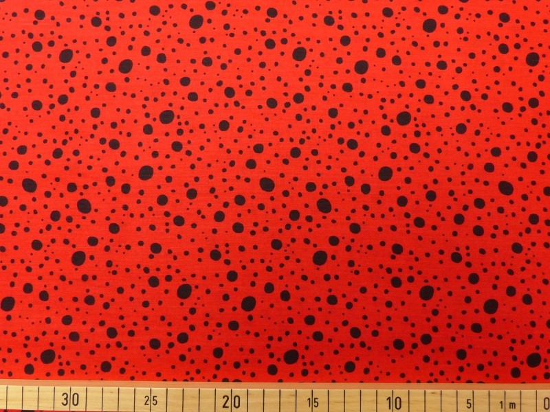 Dots black on red